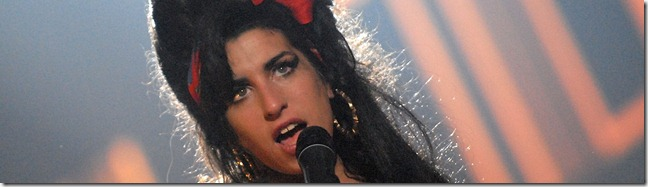 "MUNICH, GERMANY - NOVEMBER 01:  Singer Amy Winehouse performs ""Back to Black"" on stage during the 2007 MTV Europe Music Awards held at the Olympiahalle on November 1, 2007 in Munich, Germany.  (Photo by Jeff Kravitz/FilmMagic)"